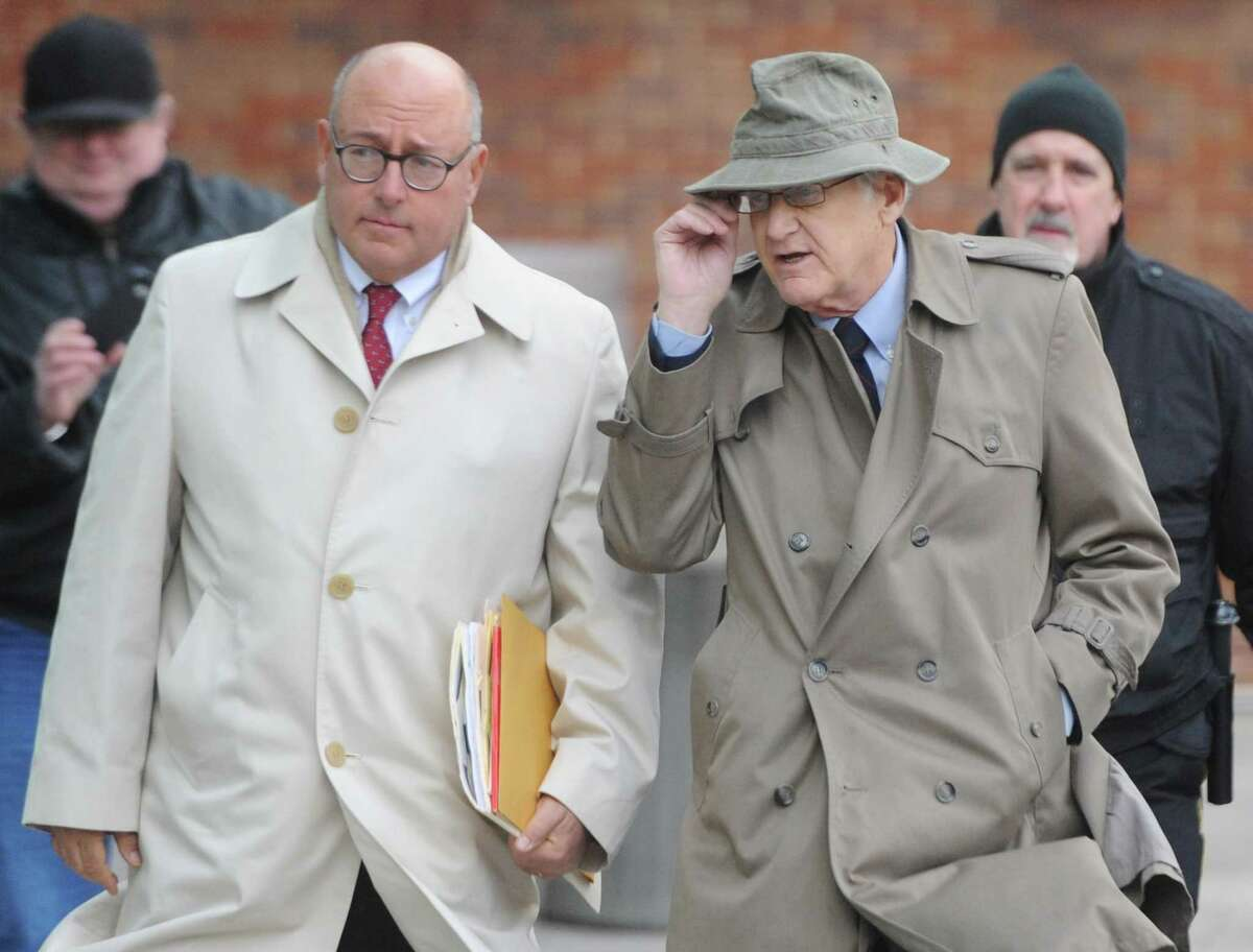 Greenwich Representative Town Meeting (RTM) member Christopher von Keyserling, right, and his attorney Phil Russel enter the Connecticut Superior Court in Stamford, Conn. Wednesday, Jan. 25, 2017. Von Keyserling is accused of fourth-degree sexual assault after allegedly groping a woman following an argument between the two in December. The Center for Sexual Assault Crisis Counseling and Education and community activists peacefully assembled as von Keyserling entered and exited the courthouse.