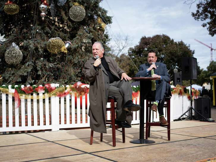 Joe Arciniega, left, portrays his distant relative José Miguel de Arciniega, a military explorer and state legislator who served as mayor of San Antonio in 1830 and 1833, during the opening ceremony of San Antonio Founders Day Christmas at Travis Park on Sunday, December 16, 2018.