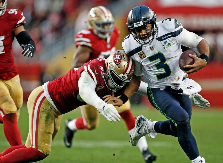 San Francisco 49ers' DeForest Buckner tackles Seattle Seahawks' Russell Wilson in 4th quarter during Niners' 26-23 win in overtime in NFL game at Levi's Stadium in Santa Clara, Calif. on Sunday, December 16, 2018. Photo: Scott Strazzante / The Chronicle 2018