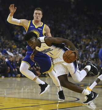 3of18Orlando Magic s Jonathan Isaac (1) drives the ball against Golden  State Warriors  Jonas Jerebko during the first half of an NBA basketball  game Monday 700f93402