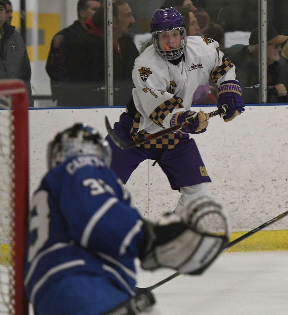 CBA forward Hunter Pemrick shoots the puck at La Salle goaltender Leo Paul during a game on Saturday, Dec. 8, 2018 at Albany County Hockey Facility in Albany, N.Y. (Jenn March, Special to the Times Union )