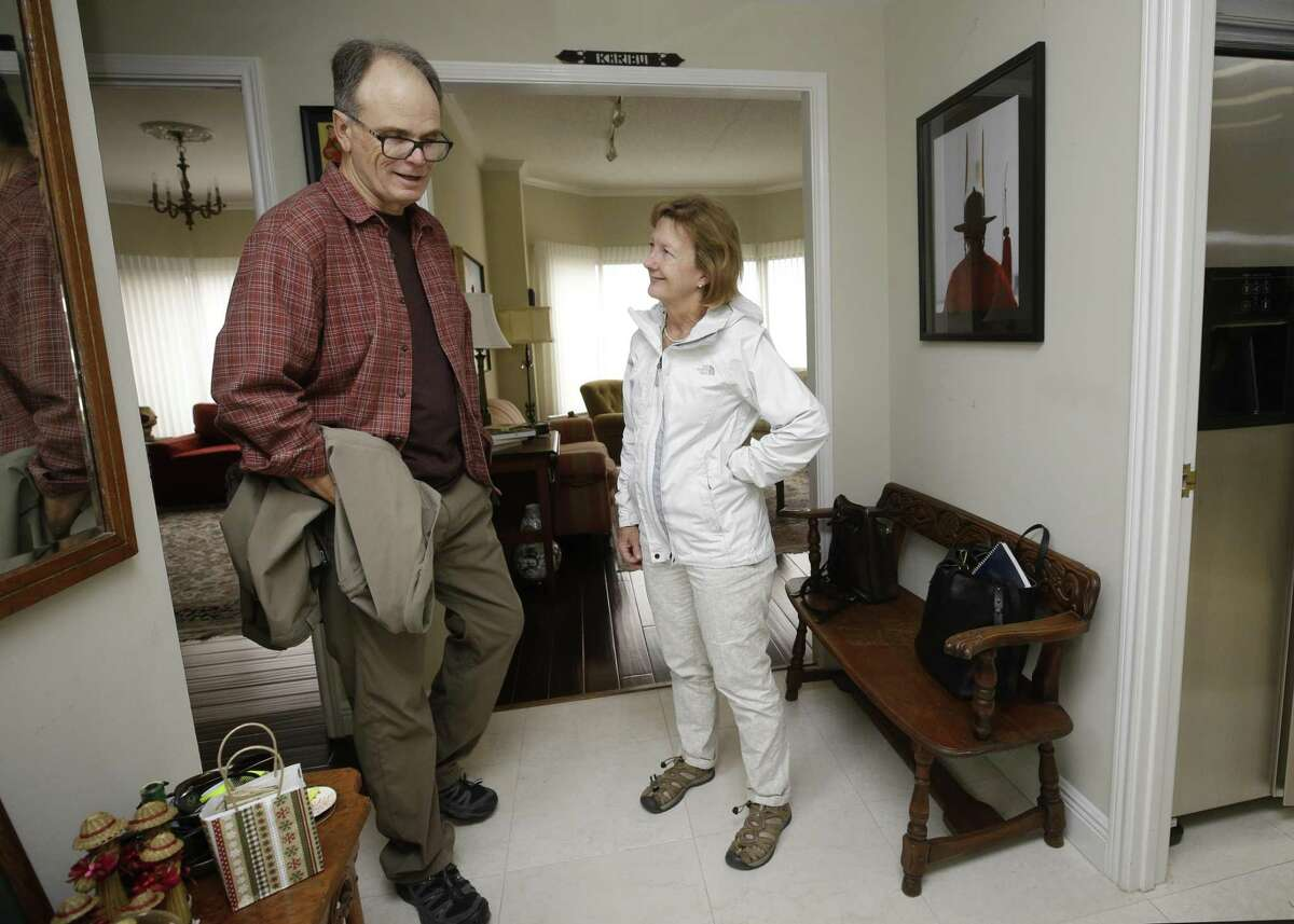 Kathy Kokas and her husband, Tom King, prepare to go on a walk to Hermann Park from their nearby home Wednesday, Dec. 12, 2018, in Houston. They are among a group of people, who are spearheading CoHousing Houston, a project that would become the first cohousing development in Texas.