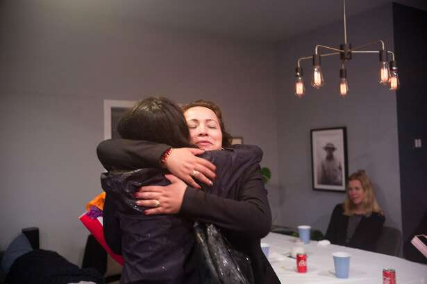 Maria Mendoza-Sanchez hugs a friend during a party for her return to Oakland, Calif. on Sunday, Dec. 16, 2018. The Oakland nurse was deported to Mexico but returned on Saturday with an H1B visa