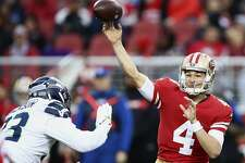 San Francisco 49ers quarterback Nick Mullens (4) passes as Seattle Seahawks defensive end Branden Jackson applies pressure during the first half of an NFL football game in Santa Clara, Calif., Sunday, Dec. 16, 2018. (AP Photo/Ben Margot)