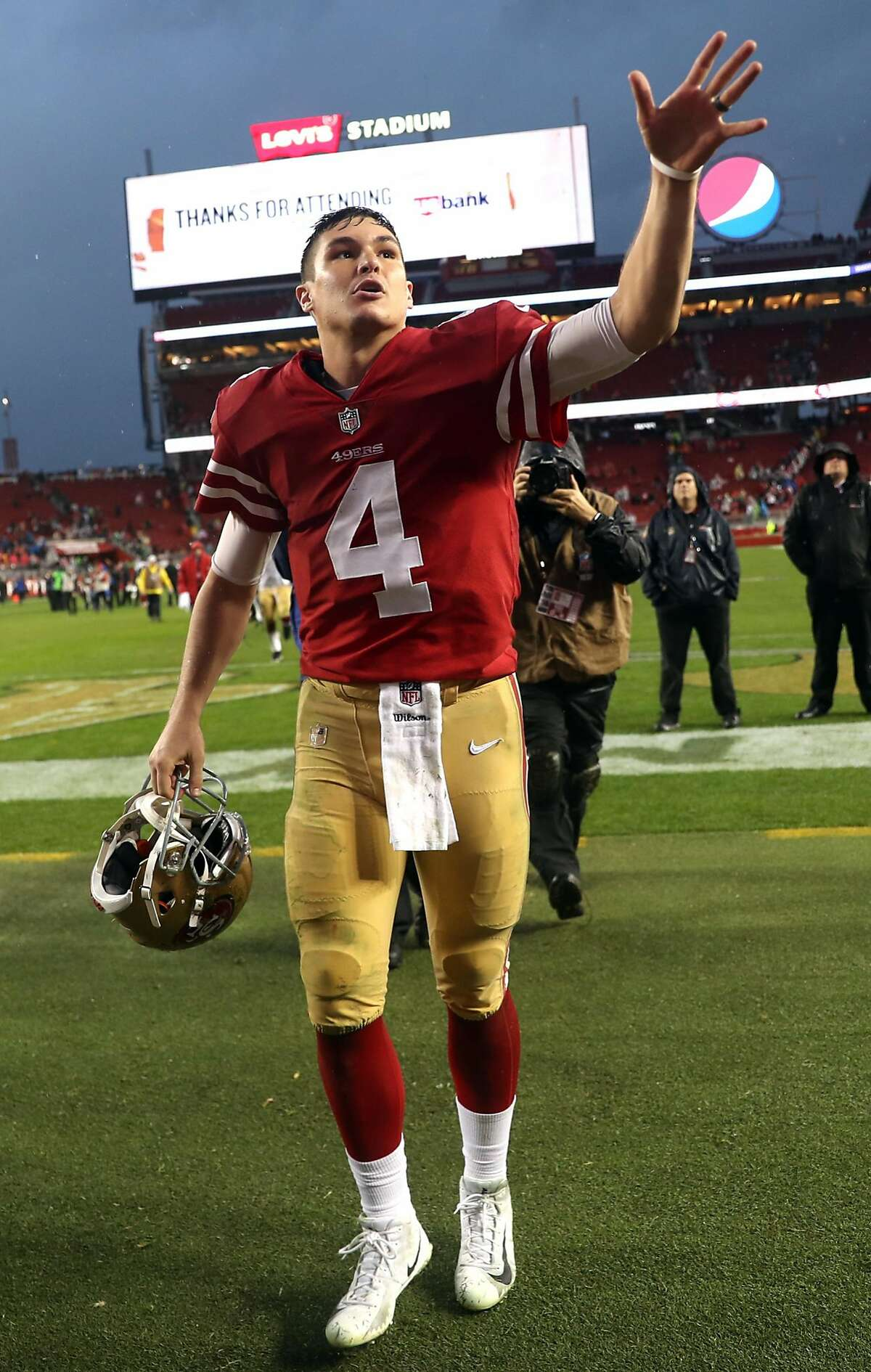 San Francisco 49ers' Nick Mullens leaves the field after Niners' 26-23 win over Seattle Seahawks in overtime in NFL game at Levi's Stadium in Santa Clara, Calif. on Sunday, December 16, 2018.