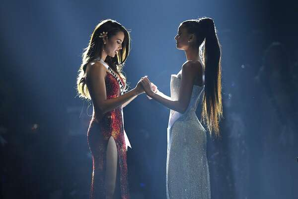 Top two finalists Catriona Gray of the Philippines (L) and Tamaryn Green of South Africa hold hands while waiting for the announcement of the winner during the 2018 Miss Universe Pageant in Bangkok on December 17, 2018. (Photo by Lillian SUWANRUMPHA / AFP)LILLIAN SUWANRUMPHA/AFP/Getty Images