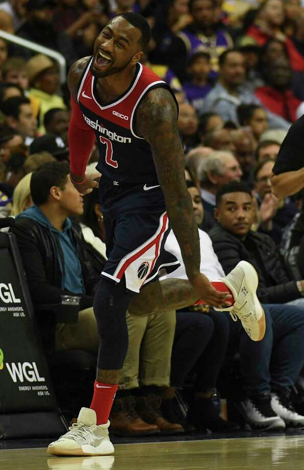 Washington Wizards guard John Wall celebrates a 3-pointer in the second half of the game against the Los Angeles Lakers at Capital One Arena on Sunday. Photo: Washington Post Photo By Toni L. Sandys. / The Washington Post