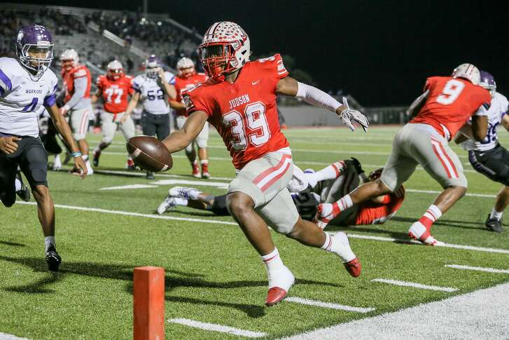 Judson's Rashad Wisdom stretches the ball towards the goal line on a nine-yard touchdown run during the first half of their Class 6A Division I bidistrict football game with Warren at Rutledge Stadium on Friday, Nov. 17, 2017. Judson beat Warren 55-14. MARVIN PFEIFFER/mpfeiffer@express-news.net