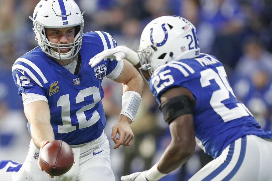 Indianapolis Colts quarterback Andrew Luck (12) hands off to Indianapolis Colts running back Marlon Mack (25) against the Dallas Cowboys on Sunday, Dec. 16, 2018 at Lucas Oil Stadium in Indianapolis, Ind. (Sam Riche/TNS)