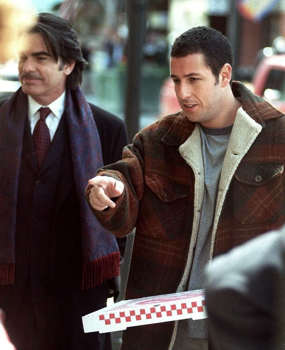 Adam Sandler, right, in a scene from the filming of his movie,