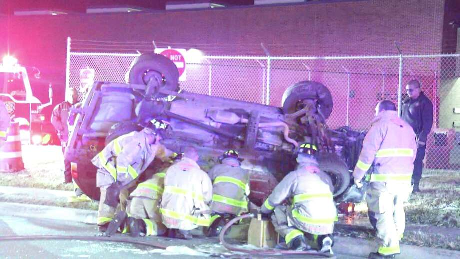 Police say a woman was hospitalized with a broken arm early Monday December 17, 2018 after a rollover crash on the West Side. Photo: Ken Branca
