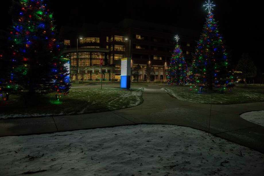 The campus of MidMichigan Medical Center - Midland was recently illuminated with the lighting of the Love Light Trees. Nearly $30,000 has been donated thus far to the MidMichigan Health Foundation for the Love Light Trees program to support equipment needs and patient enhancements for the medical center in Midland. (Photo provided)
