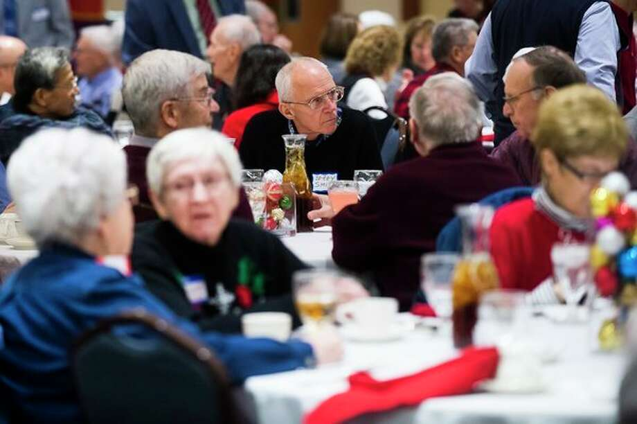 People gather for the Dow Corning Retirees' Club Christmas party on Tuesday at the Great Hall Banquet & Convention Center in Midland. (Katy Kildee/kkildee@mdn.net)