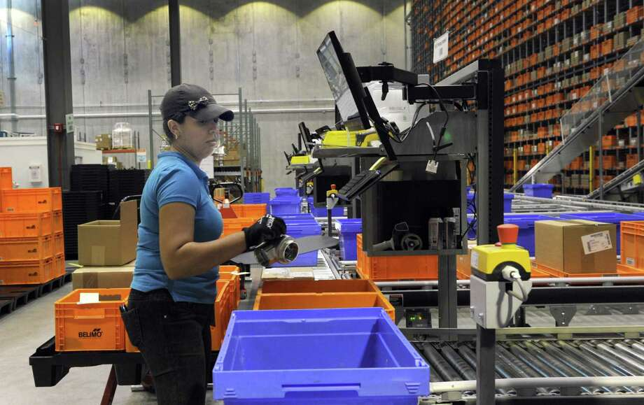 A Belimo Americas employee processes an order in August 2017 at the company's assembly facility in Danbury, Conn. Photo: Carol Kaliff / Hearst Connecticut Media / The News-Times
