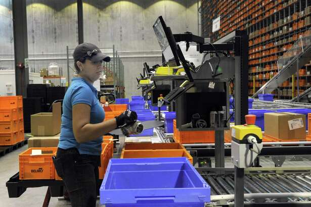 A Belimo Americas employee processes an order in August 2017 at the company's assembly facility in Danbury, Conn.