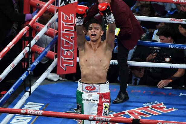 LAS VEGAS, NV - SEPTEMBER 15: Jaime Munguia celebrates his fifth-round TKO against Brandon Cook during their WBO junior middleweight title fight at T-Mobile Arena on September 15, 2018 in Las Vegas, Nevada. (Photo by Ethan Miller/Getty Images)