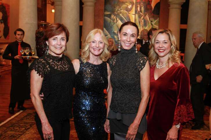 EMBARGOED FOR SOCIETY REPORTER UNTIL DEC. 14  Jennifer Huber, from left, Trish Morille, Sue Smith and Dr. Julie Baker Finck at A Celebration of Reading, Sue and Lester Smith's holiday party.