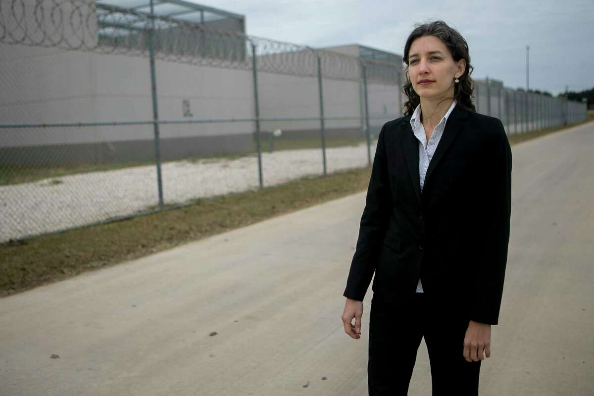 """Sara Ramey, executive director of the Migrant Center for Human Rights, poses outside the South Texas Detention Complex, one of the largest detention centers in the country, where she represents clients Dec. 5, 2018. """"Here in the U.S. we have a strong constitution and without education and services... people really don't have any way of effectively presenting immigration cases to judges,"""" says Ramey of the importance of her work. People often don't realize how difficult it is for people to go through the legal process and when individuals have a lawyer their chances are increased by four times explains Ramey. """"People need to have their right to due process,"""" says Ramey."""