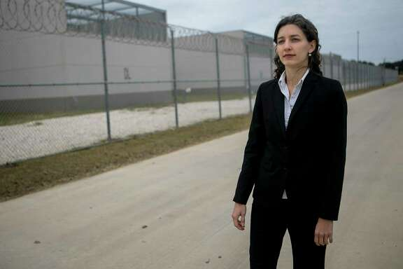 "Sara Ramey, executive director of the Migrant Center for Human Rights, poses outside the South Texas Detention Complex, one of the largest detention centers in the country, where she represents clients Dec. 5, 2018. ""Here in the U.S. we have a strong constitution and without education and services... people really don't have any way of effectively presenting immigration cases to judges,"" says Ramey of the importance of her work. People often don't realize how difficult it is for people to go through the legal process and when individuals have a lawyer their chances are increased by four times explains Ramey. ""People need to have their right to due process,"" says Ramey."