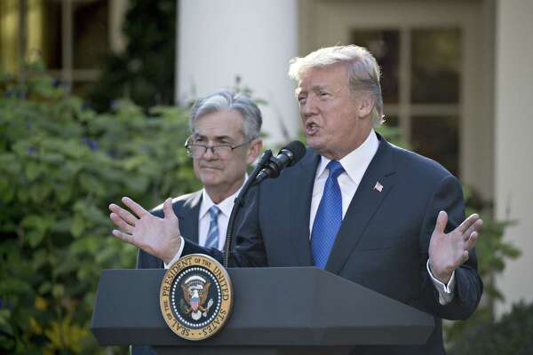 President Donald Trump speaks as Jerome Powell. then a governor of the Federal Reserve, listens in the Rose Garden of the White House in Washington, D.C., as Trump nominated Powell for Fed chairman on Nov. 2, 2017.