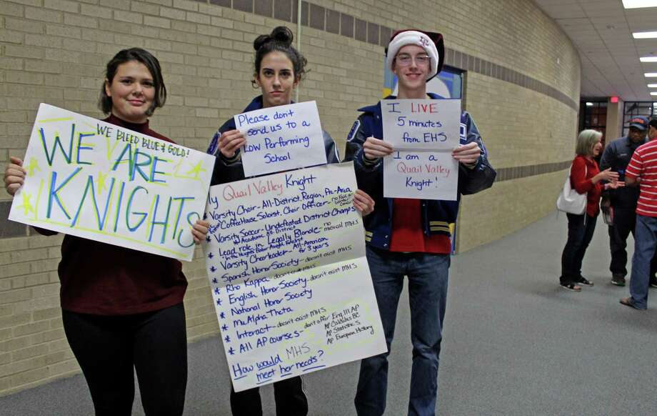 Students hold up signs protesting plans for proposed rezoning during a Fort Bend ISD town hall meeting at Elkins High School on Thursday, Dec. 14. Photo: Kristi Nix / Staff Photo