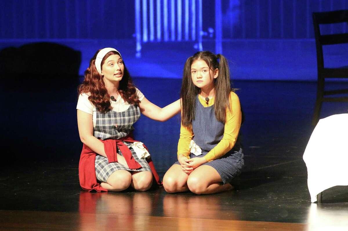 Annie (Alicia Shelton) and Molly (Ellie Ellison) sing