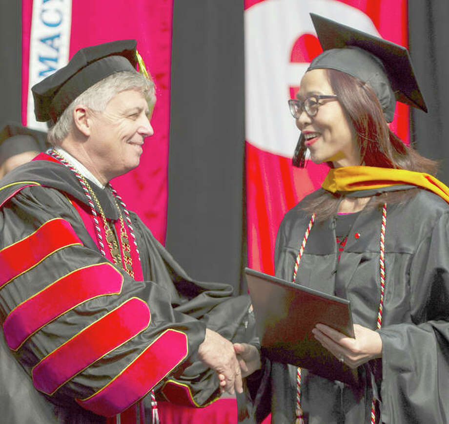 Southern Illinois University Edwardsville Chancellor Randy Pembrook presents one of 1,217 degrees awarded to eligible graduates during three ceremonies over two days this past weekend. Photo: For The Telegraph