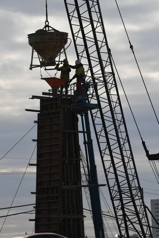 Workers prepare to pour cement to make the obelisks to the Purple Heart Bridge.   Photo taken 1-5-18 Guiseppe Barranco/The Enterprise Photo: Guiseppe Barranco