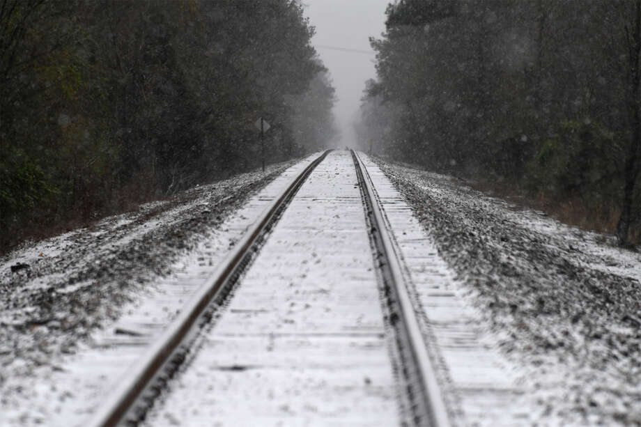 Snow on train tracks near Silsbee on Tuesday Tuesday, January 16, 2017. Flip through for more photos from last year's snow event. Photo: Guiseppe Barranco / Guiseppe Barranco ?