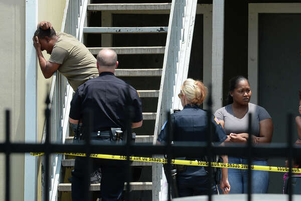 A woman cries out at Beaumont's Autumn Oaks Apartments after a shooting that killed one man on Tuesday. Police are looking for an older model Chevy Tahoe in connection with the shooting. The homicide is the ninth in the city this year. Photo taken Tuesday, 7/24/18