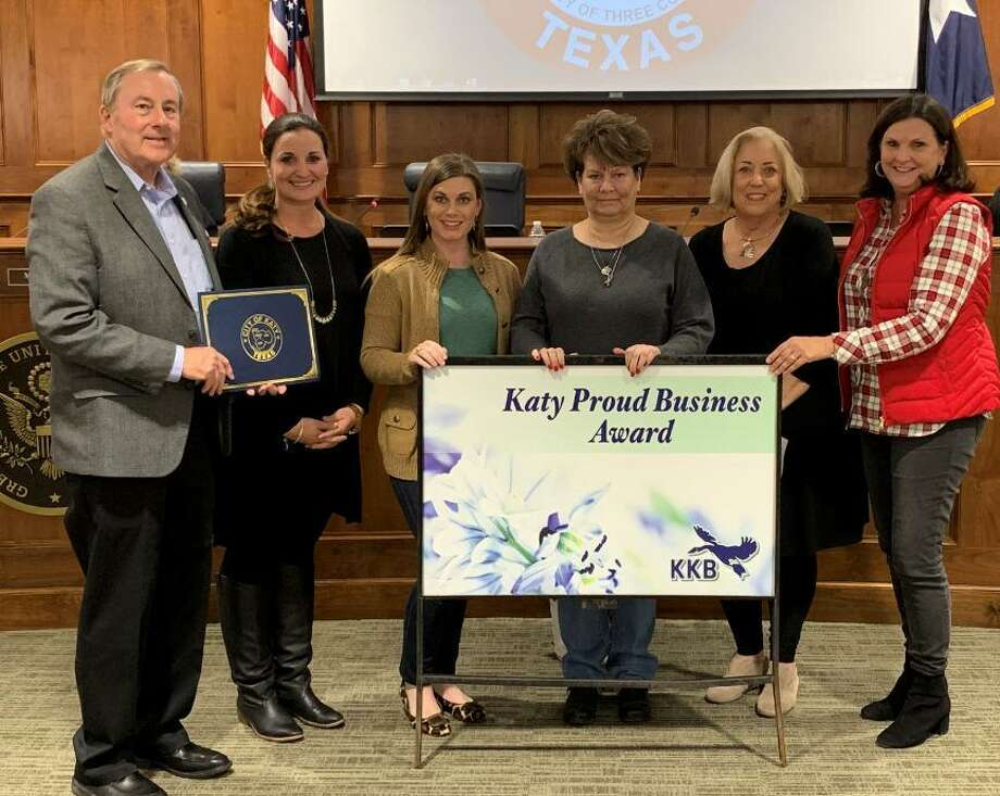 Keep Katy Beautiful presented the Katy Proud Business Award Dec. 10 to Megan Morgan, owner of Vintage Back Roads, located at 813 Ave. B in downtown Katy. She first opened her store on April 1, 2013 and then moved to the larger space on Avenue B in May 2017. Her co-op features more than 30 local vendors. Participating in the Dec. 10 presentation were, from left: Mayor Chuck Brawner Carrie Singletary, Megan Bishop, Megan Morgan, Jamie Wolman and Jacalyn Warner. Photo: City Of Katy / City Of Katy