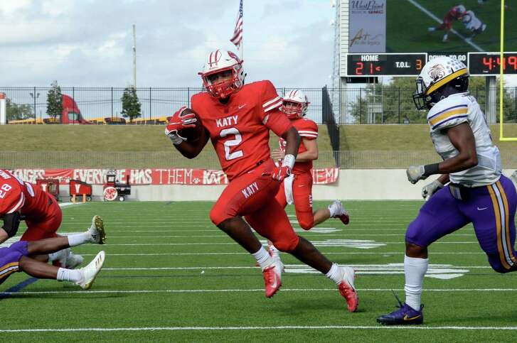 Deondrick Glass (2) of Katy rushes for a touchdown in the first quarter of a Class 6A Div. I Reg. III area-round playoff game between the Katy Tigers and the Jersey Village Falcons on Friday, November 23, 2018 at Legacy Stadium, Katy, TX.