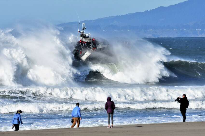 Dave Rogers of Pacifica captured two 47-foot-long motor lifeboats being tossed in big waves at San Francisco's Ocean Beach during a training by the U.S. Coast Guard's Golden Gate Station on Dec. 13, 2018. This was a standard training.