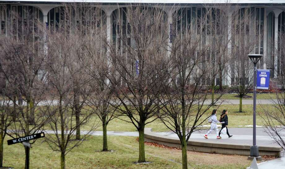 The temperature is on the rise in the Albany area and could get close to 60 degrees on Friday. In this photo, students make their way through the University at Albany campus on Monday, Dec. 17, 2018, in Albany, N.Y.  (Paul Buckowski/Times Union) Photo: Paul Buckowski, Albany Times Union / (Paul Buckowski/Times Union)