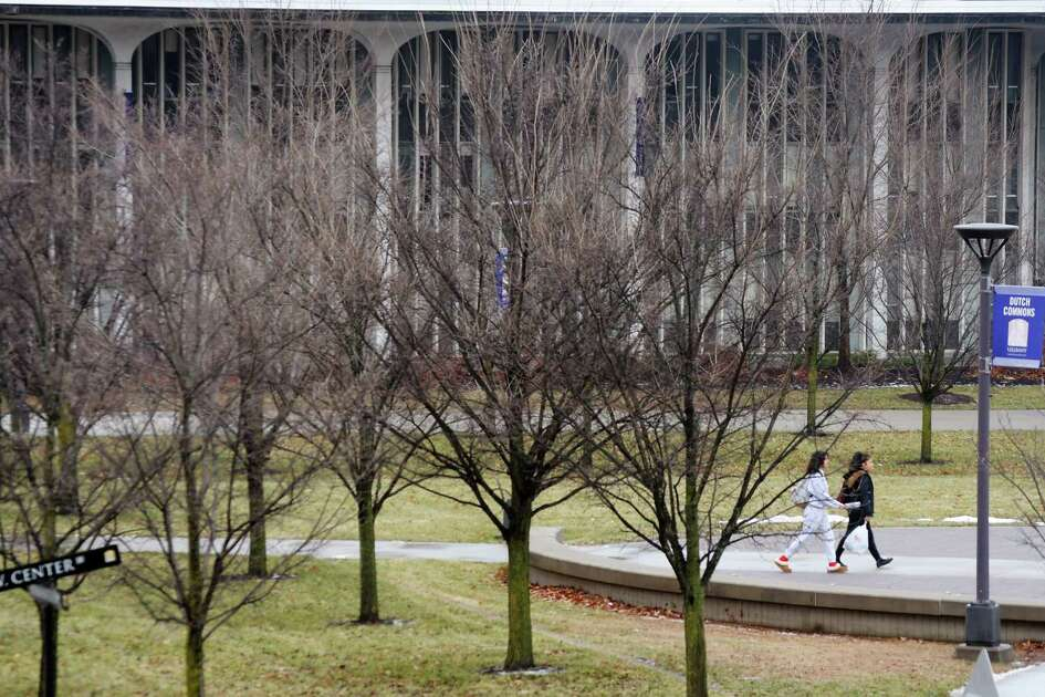 Students make their way through the University at Albany campus on Monday, Dec. 17, 2018, in Albany, N.Y. (Paul Buckowski/Times Union)