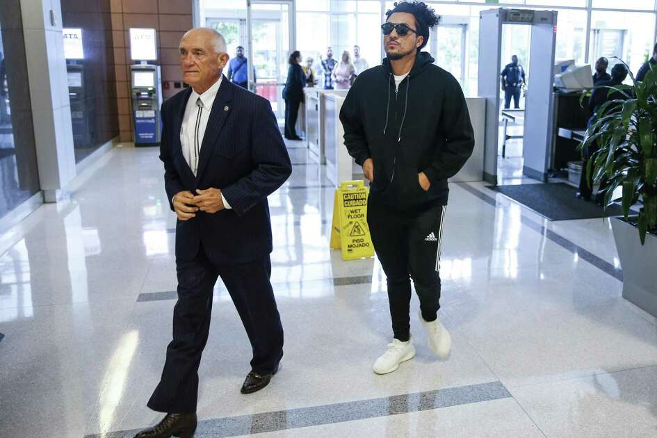 Michael Anthony Cuellar, 29, turns himself in with his lawyer, Paul Looney, left, at the Harris County Juvenile Courthouse after he was identified as one of the shooters in a now-viral Snapchat video Tuesday, Oct. 3, 2017 in Houston. The video allegedly showed Cuellar and a passenger, Sierra Tarbutton, shooting from a car near the 15800 block of Memorial Drive. ( Michael Ciaglo / Houston Chronicle)