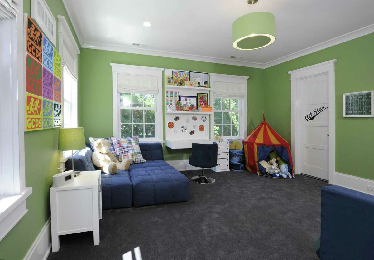The 2009-built contemporary colonial at 15 Pinecroft Road has five bedrooms, ensuring several options for children. This bedroom has a built-in workstation and shelves. The property is listed for $5.95 million.