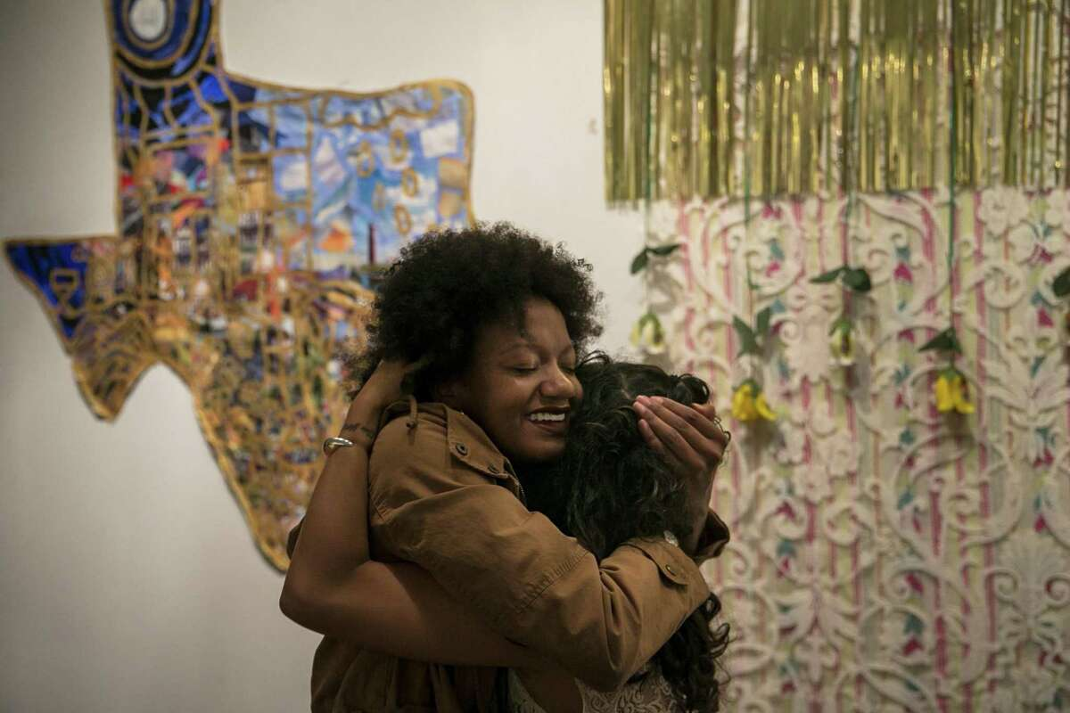 Kimiya Factory, 20, embraces Erica Alcocer, organizer of the VOZ exhibit at The Movement Gallery that featured work of survivors of sexual violence on Dec. 8, 2018. Factory, as well as Taylor Waits and other students, have been working to voice their dissatisfaction with UTSA's handling of sexual assault investigations. They say they want to change the 'rape culture' on campus. 'The movement made itself but we kind of just listened,' Factory says. 'What we're doing and what we're fighting for is important because normally this conversation (around sexual assault) dies out and people are scared to come forward with their stories or the rapists think that people just forget.'