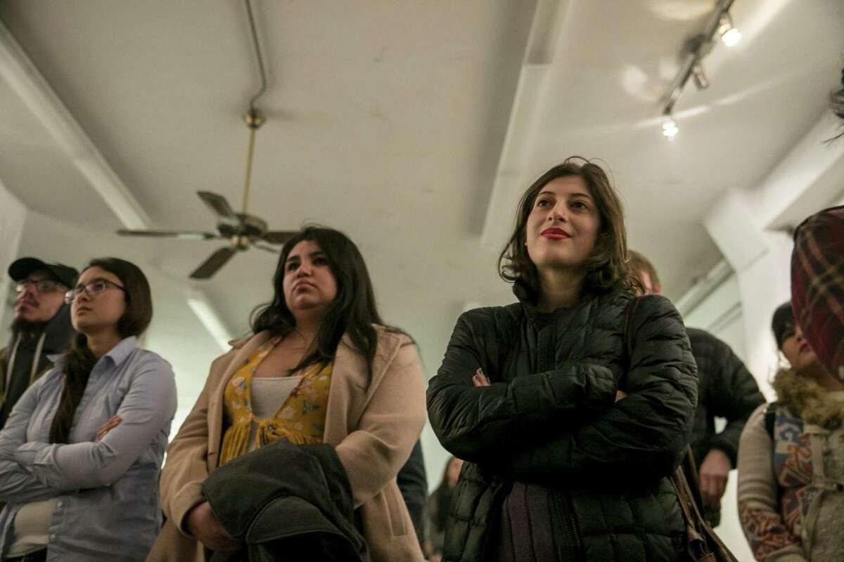 Audience members listen to Kimiya Factory, 20, as she shares her poem 'Hold My Hand' during the VOZ exhibit at The Movement Gallery that featured work of survivors of sexual violence on Dec. 8, 2018. Factory, as well as Taylor Waits and other students, have been working to voice their dissatisfaction with UTSA's handling of sexual assault investigations. They say they want to change the 'rape culture' on campus.