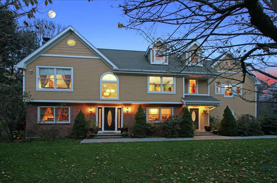 Built in 1965 and recently updated, this five-bedroom colonial at 4 Coachmans Court in Norwalk is listed for $990,000. Photo: LLA Real Estate Group, Executive Premier Properties / ONLINE_CHECK