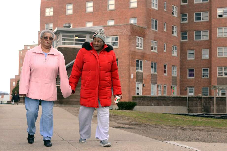 Tenant commissioner Bettie Cook, left, and resident Alice king was through the Charles F. Greene homes, in Bridgeport, Conn. Dec. 17, 2018. On Monday the City of Bridgeport announced new efforts to clean and maintain the aging housing complex. Photo: Ned Gerard / Hearst Connecticut Media / Connecticut Post