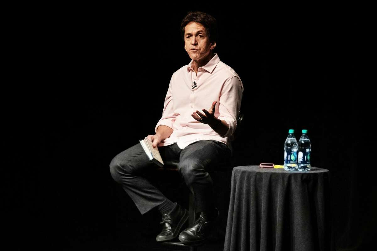 """Mitch Albom speaks about his history as a writer and his new book, """"The Next Person You Meet in Heaven,"""" during a reading at the Midland Center for the Arts Sunday, Dec. 16, 2018. (Steven Simpkins/for the Daily News)"""