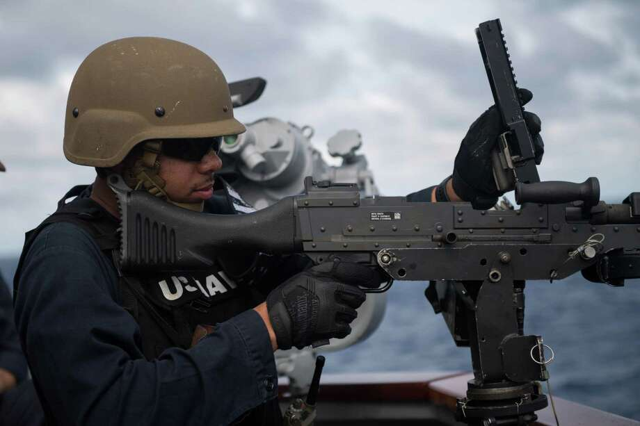U.S. Navy Gunner's Mate 2nd Class Kimani Williams, from Houston, reloads an M240 machine gun during a live-fire exercise aboard the guided-missile destroyer USS Stockdale (DDG 106) in the Indian Ocean on Dec. 6, 2018. The John C. Stennis Carrier Strike Group is deployed to the U.S. 5th Fleet area of operations in support of naval operations to ensure maritime stability and security in the Central Region, connecting the Mediterranean and the Pacific through the western Indian Ocean and three strategic choke points. Photo: Mass Communication Specialist 2nd Class AbigayleLutz, NPASE West / U.S. Navy Photo / PUBLIC DOMAIN