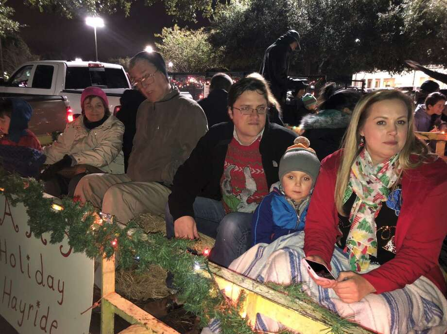 Austin High School ProGrad hosts hayrides in early December to take people through the Pecan Grove neighborhood to view the holiday lights. It's a tradition and fundraiser. Photo: Beth A. Hall / Beth A. Hall