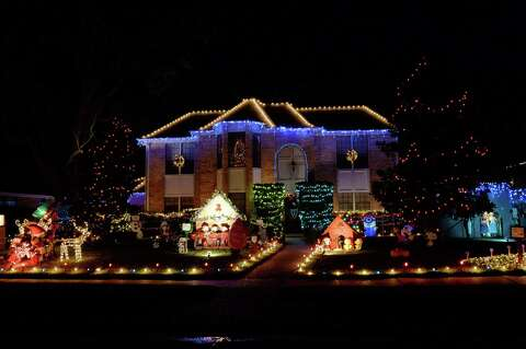 <p>Holiday lights displayed in Pecan Grove on Thursday, Dec. 13, - Pecan Grove Bedecked For Holidays - Houston Chronicle