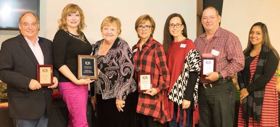 The Katy Business Association honored local nonprofits and its Business of the Year at its recent Christmas celebration. The honorees are, from left: John Garnsey of Katy Cares; Jennifer Pierce of Chick-fil-A; ClaraJean Machann, KBA president; Dina Purdy, volunteer coordinator and Norma Zubiate, client service director with the Pregnancy Help Center of West Houston; Sgt. Scott Arnold, president of the Katy Police Officers Association; and Pricilla Gonzalez, secretary for Katy Police Chief Bill Hastings. Photo: Katy Business Association / Katy Business Association