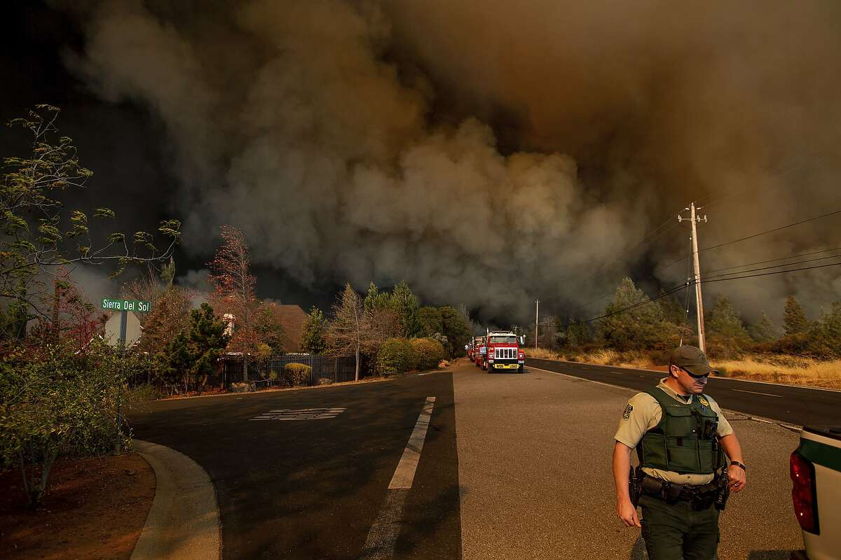 FILE - In this Nov. 8, 2018 file photo the Camp Fire rages through Paradise, Calif. Insurance claims from last month's California wildfires already are at $9 billion and expected to increase, the state's insurance commissioner announced Wednesday, Dec. 12. (AP Photo/Noah Berger, File)