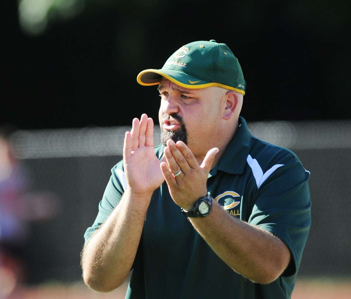Donny Panapada, the Trinity Catholic High School football coach, during the game between Greenwich High School and Trinity Catholic High School at Greenwich, Conn., Saturday, Sept. 15, 2018.