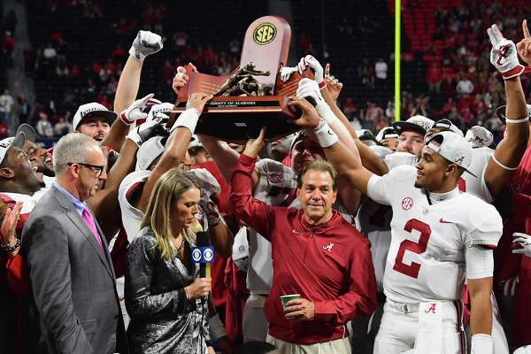 ATLANTA, GA - DECEMBER 01: Head coach Nick Saban and the Alabama Crimson Tide celebrate with the trophy after defeating the Georgia Bulldogs 35-28 in the 2018 SEC Championship Game at Mercedes-Benz Stadium on December 1, 2018 in Atlanta, Georgia.