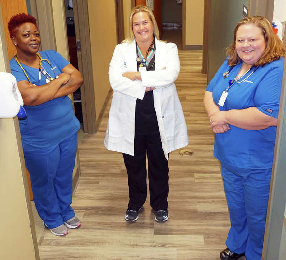 Alton Memorial Convenient Care staff members standing on the new vinyl flooring are, left to right, Shannon Hayes, Kristine Groppel and Crystal Vetter. Photo: For The Telegraph